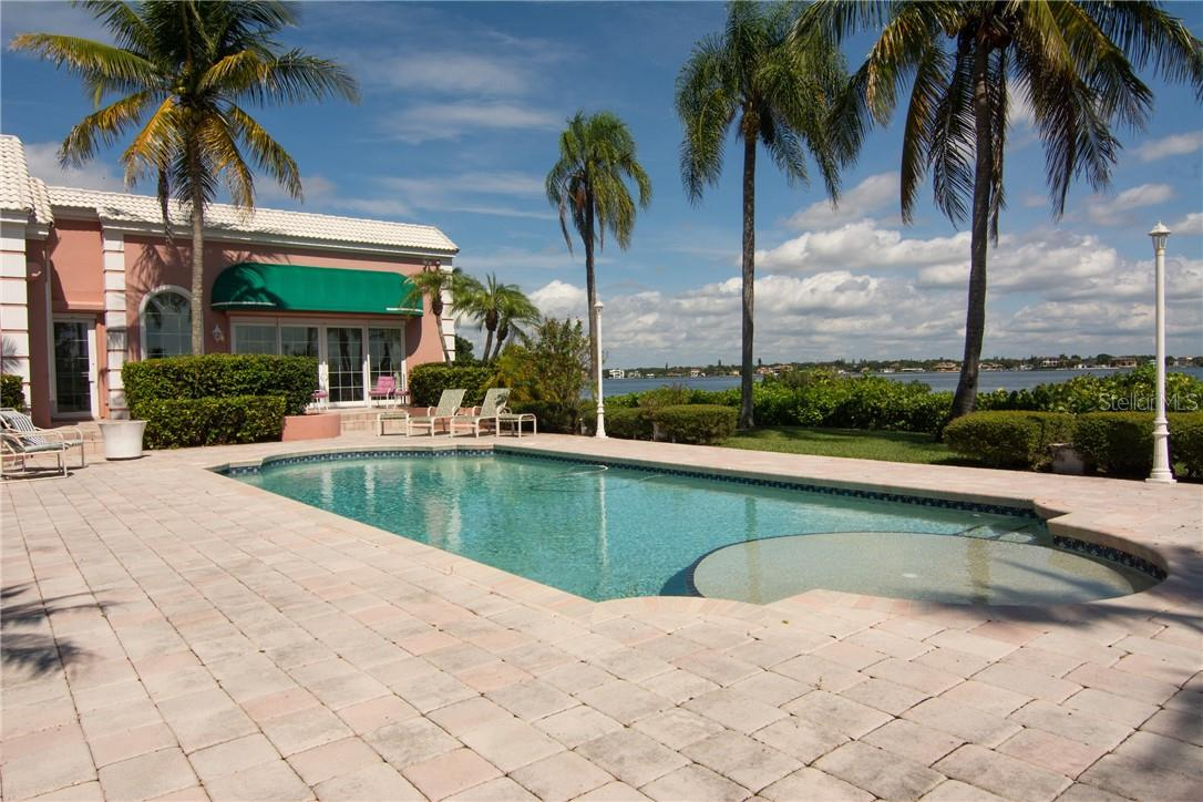 Large sunning shelf in pool. - Single Family Home for sale at Address Withheld, Sarasota, FL 34242 - MLS Number is A4483403