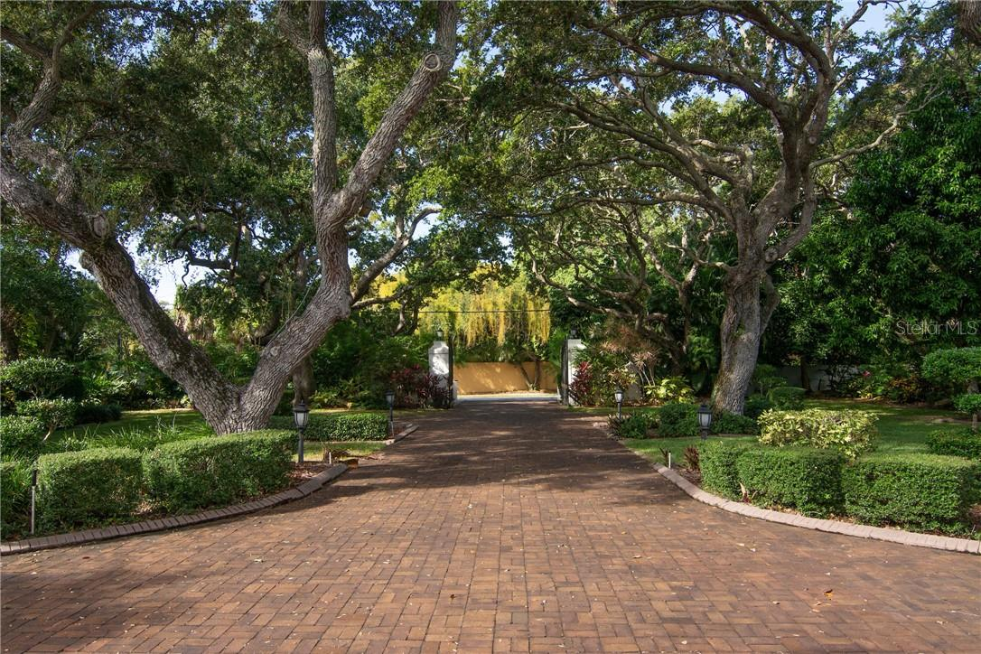 View from front looking towards entrance gates. - Single Family Home for sale at Address Withheld, Sarasota, FL 34242 - MLS Number is A4483403
