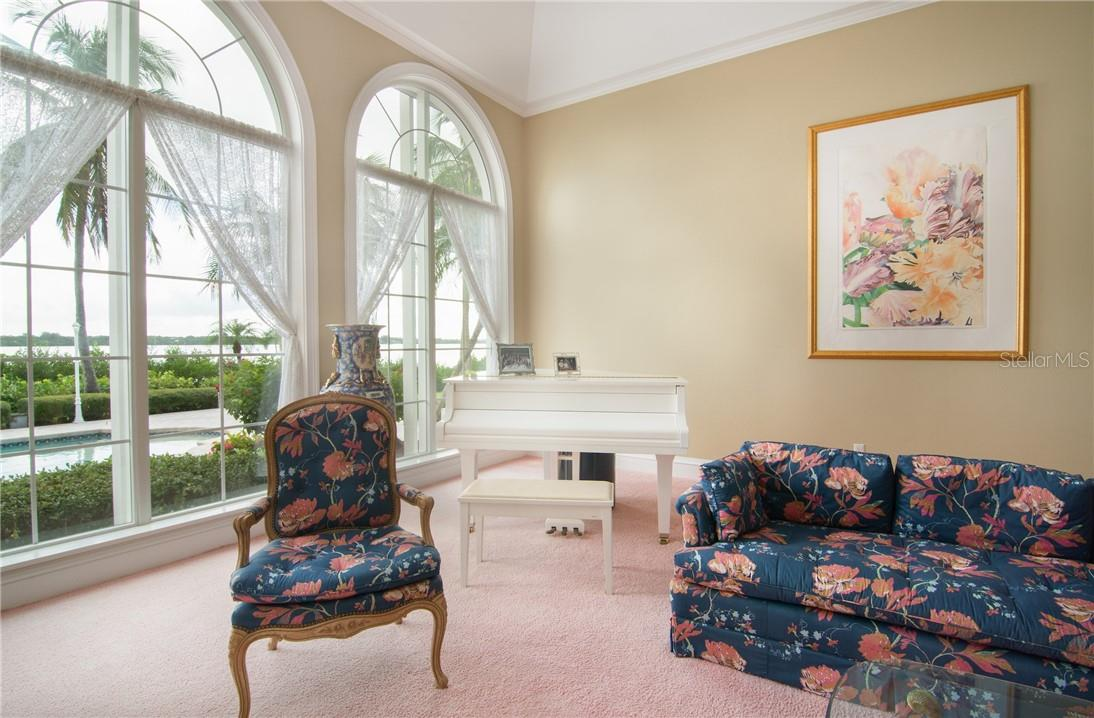 Glimpse of the pool and waterway from reception room. - Single Family Home for sale at Address Withheld, Sarasota, FL 34242 - MLS Number is A4483403