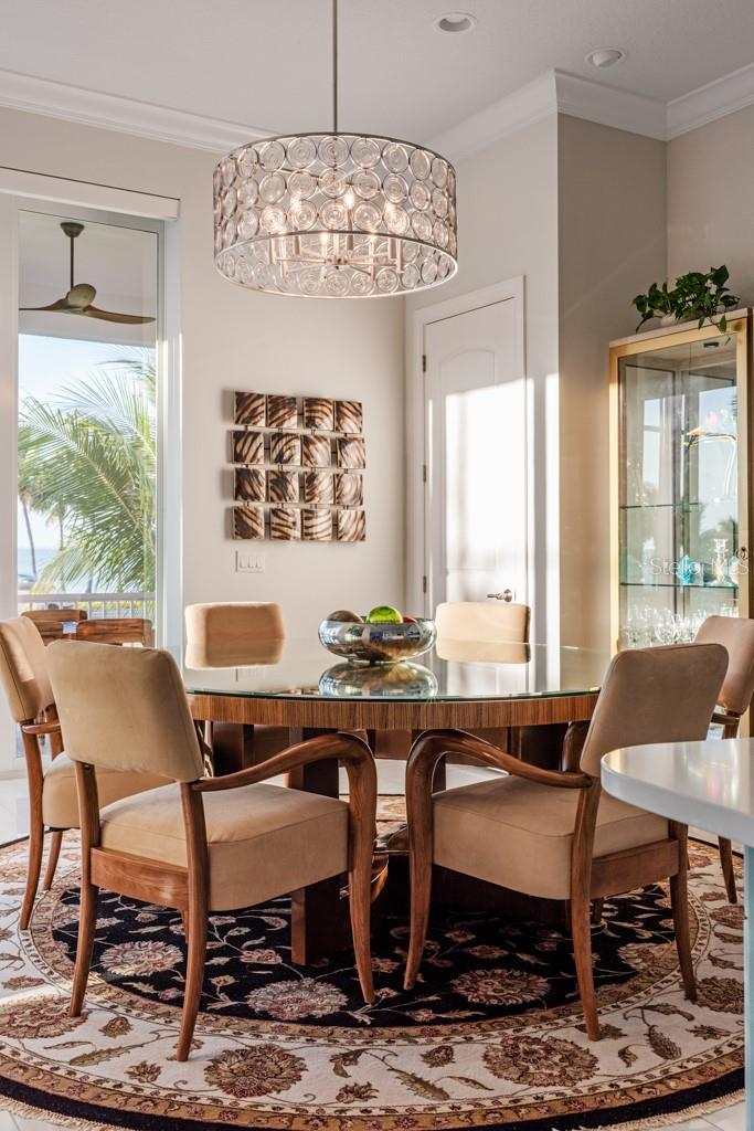 Custom Made Zebra Wood Dinning Table - Single Family Home for sale at 121 Seagull Ln, Sarasota, FL 34236 - MLS Number is A4483951