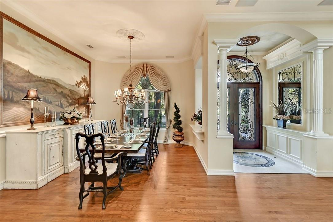 The Grande Salon is the centerpiece of this amazing property, note the custom windows, custom coral stone fireplace & hearth - Single Family Home for sale at 8263 Archers Ct, Sarasota, FL 34240 - MLS Number is A4483993