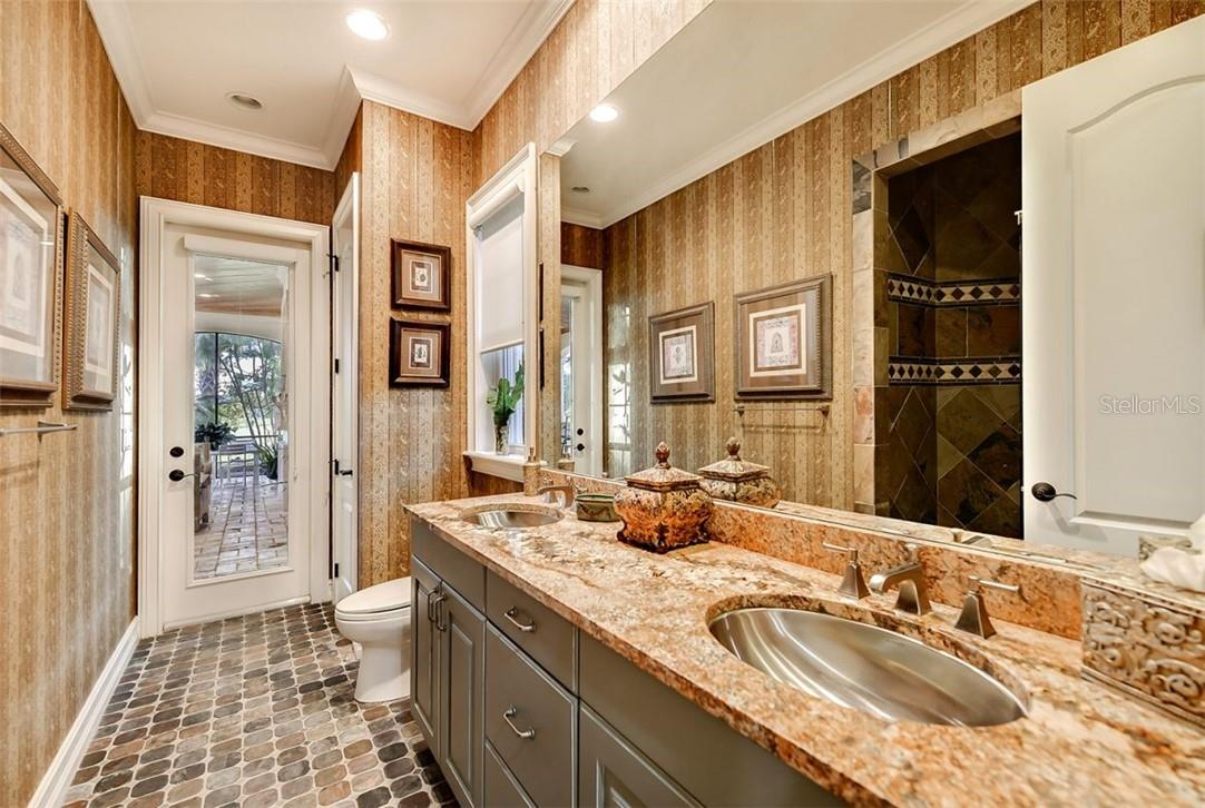 GUEST SUITE - 2 POOL BATH ALSO, DOUBLE SINKS, WALK IN SHOWER W/ SEAT , GREAT USE OF SLATE  STONE - Single Family Home for sale at 8263 Archers Ct, Sarasota, FL 34240 - MLS Number is A4483993