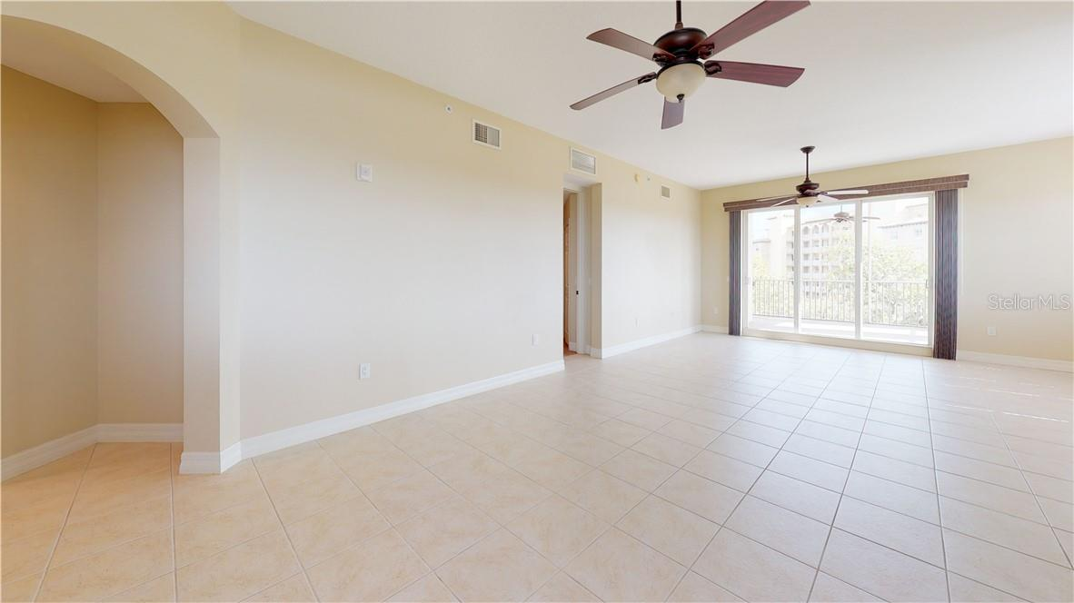 From dining area into living space and balcony - Condo for sale at 5591 Cannes Cir #506, Sarasota, FL 34231 - MLS Number is A4484243
