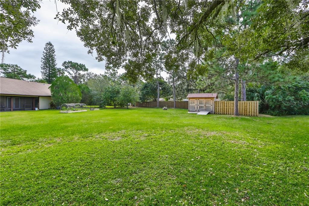 Backyard - Single Family Home for sale at 6215 Braden Run, Bradenton, FL 34202 - MLS Number is A4484627