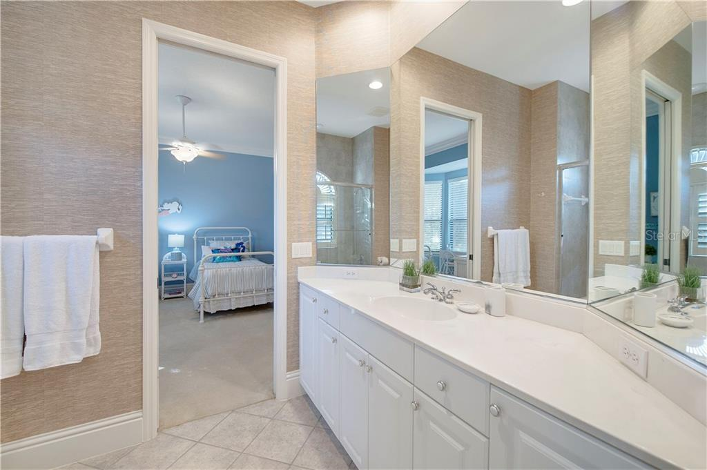 Jack-and-Jill bathroom between bedrooms 2 &3 - Single Family Home for sale at 13223 Palmers Creek Ter, Lakewood Ranch, FL 34202 - MLS Number is A4484826