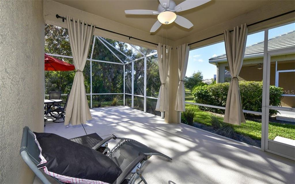 Screened lanai with pond view. - Villa for sale at 4812 Lakescene Pl, Sarasota, FL 34243 - MLS Number is A4486070