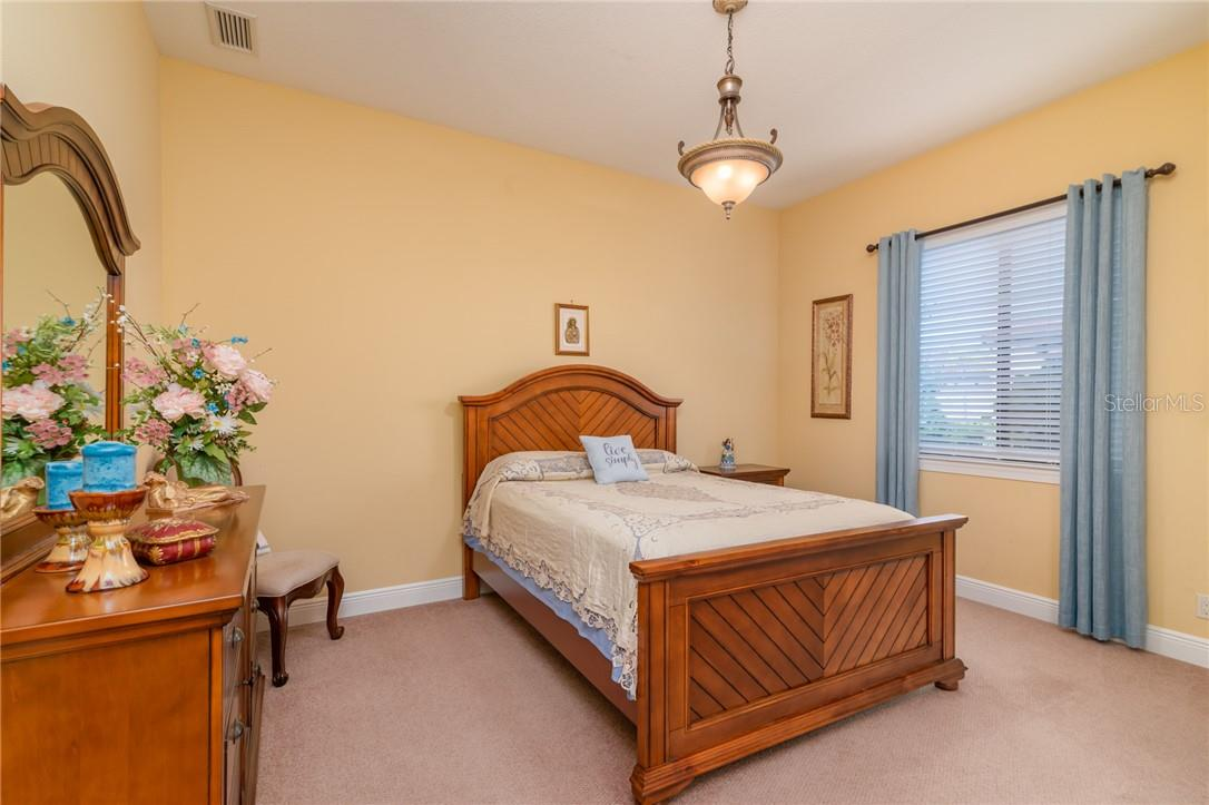 The two secondary bedrooms are large with a large closet. - Single Family Home for sale at 11720 Rive Isle Run, Parrish, FL 34219 - MLS Number is A4486302