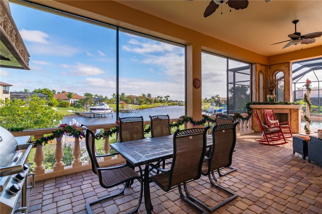 The outside dining area and seating area on the Veranda. - Single Family Home for sale at 11720 Rive Isle Run, Parrish, FL 34219 - MLS Number is A4486302