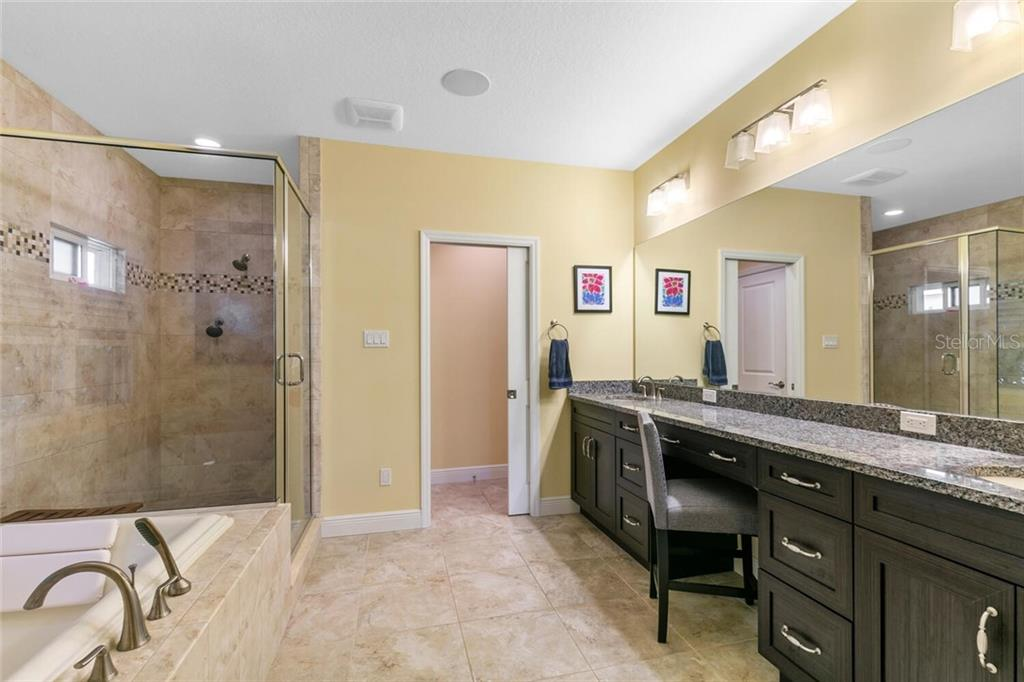 Master bath incredible vanity & mirror space. - Single Family Home for sale at 1145 Horizon View Dr, Sarasota, FL 34242 - MLS Number is A4486759