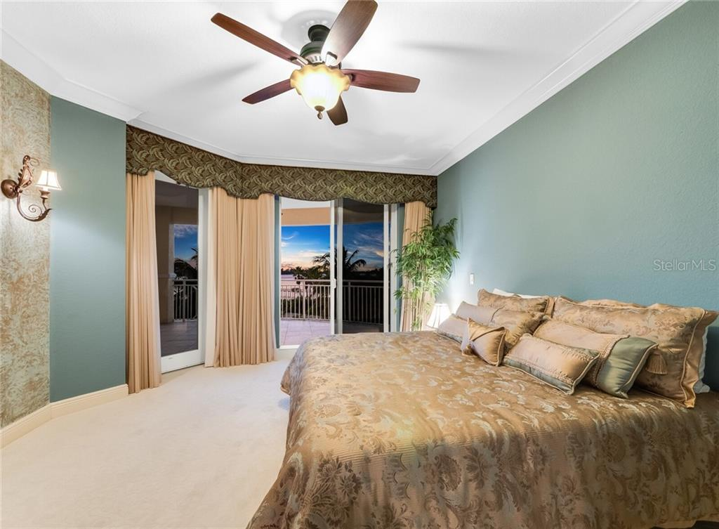 Primary Bedroom  with expansive terrrace overlooking the water. - Condo for sale at 14021 Bellagio Way #407, Osprey, FL 34229 - MLS Number is A4487552