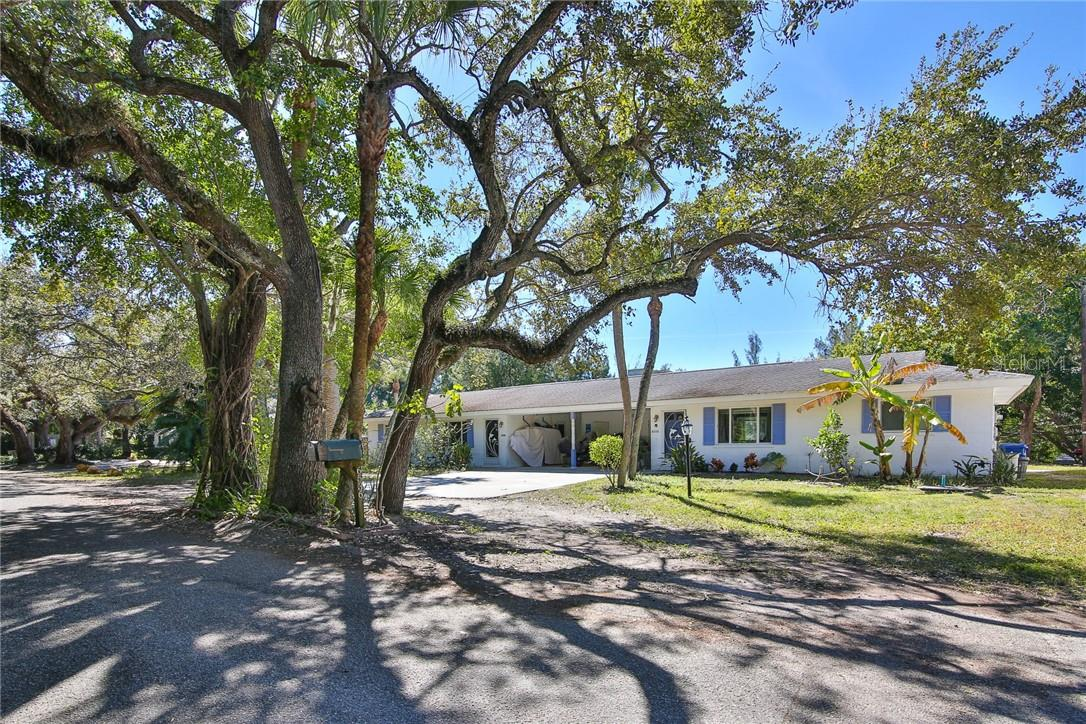 View from Peacock Rd, a quiet street with no pass-through traffic. - Duplex/Triplex for sale at 6536 Peacock Rd, Sarasota, FL 34242 - MLS Number is A4490204