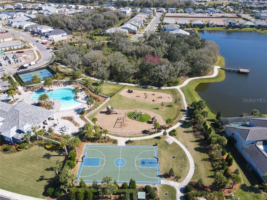 Aerial view of the Mallory Park amenity areas.  Fishing dock too. - Single Family Home for sale at 11713 Blue Hill Trl, Bradenton, FL 34211 - MLS Number is A4490622