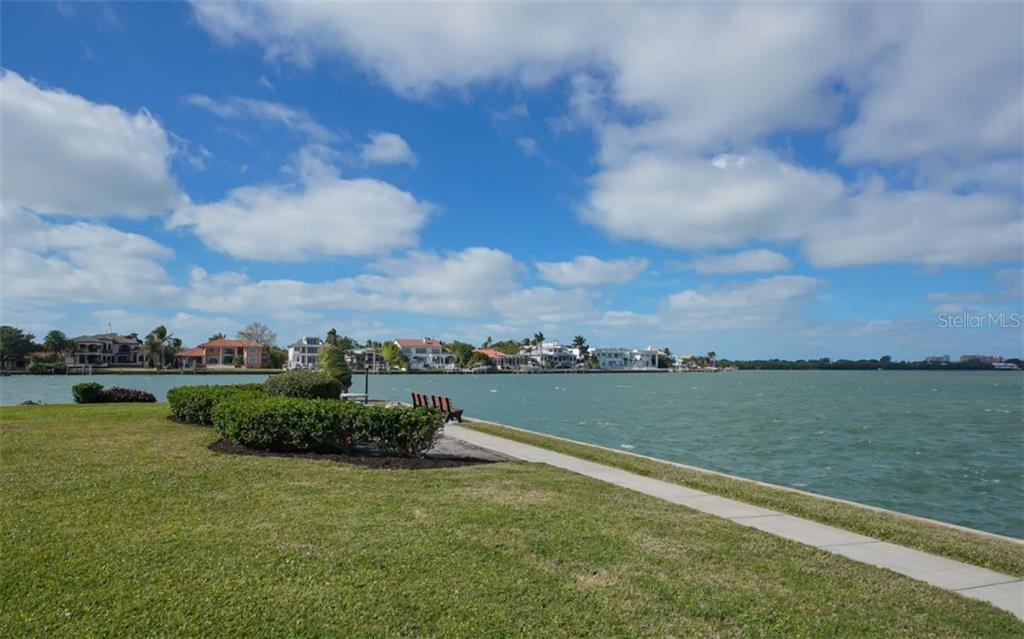 There are benches along the walkway - Condo for sale at 761 John Ringling Blvd #28, Sarasota, FL 34236 - MLS Number is A4490945