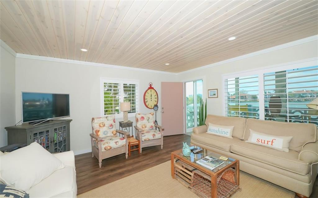 Living room opens to the front porch - Condo for sale at 761 John Ringling Blvd #28, Sarasota, FL 34236 - MLS Number is A4490945