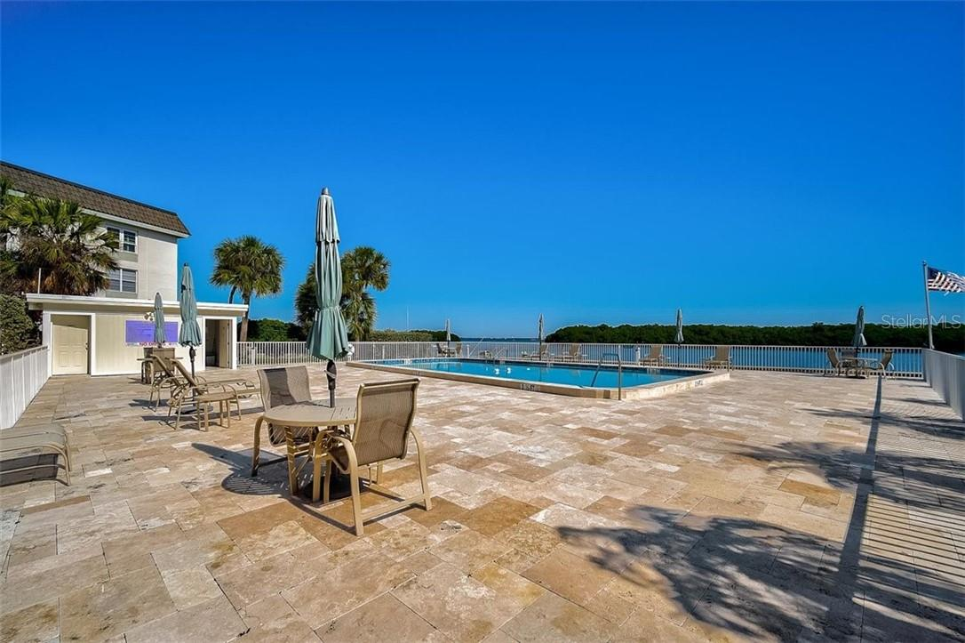 577 Sutton Place Longboat Key Florida 34228 | One of Two Heated Pools | This Pool Overlooks the Bay - Condo for sale at 577 Sutton Pl #T-25, Longboat Key, FL 34228 - MLS Number is A4492432