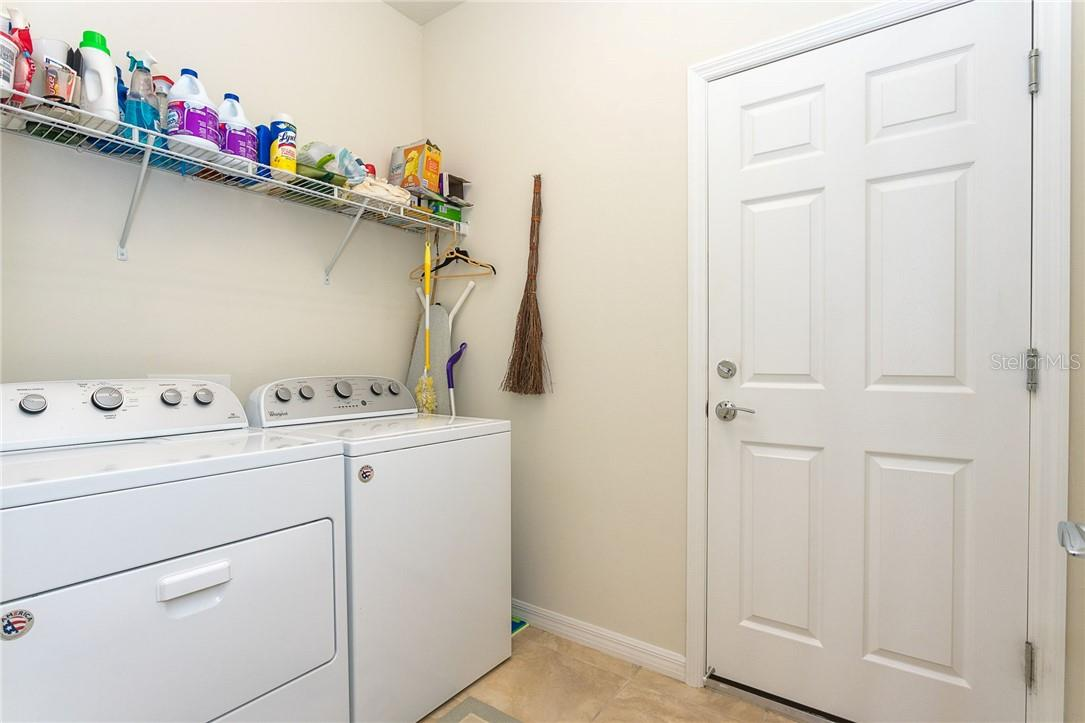 Large interior laundry room - Villa for sale at 13883 Botteri St, Venice, FL 34293 - MLS Number is A4493523