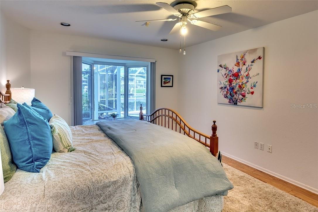 Master en-suite with amazing water views through a large bay window - Single Family Home for sale at 1908 72nd St Nw, Bradenton, FL 34209 - MLS Number is A4495621