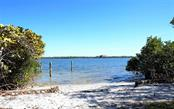 92' of frontage along Little Sarasota Bay - Vacant Land for sale at 8535 Midnight Pass Rd, Sarasota, FL 34242 - MLS Number is A4146348