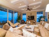 Family room with sliders to terrace with mesmerizing bay views - Single Family Home for sale at 640 Rountree Dr, Longboat Key, FL 34228 - MLS Number is A4169177