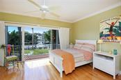 One of Two Guest Bedrooms on Second Level connected by Jack & Jill Bathroom.  Private Balcony overlooking Waterway! - Single Family Home for sale at 722 Siesta Dr, Sarasota, FL 34242 - MLS Number is A4169257