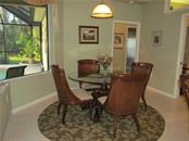 DINING AREA OFF KITCHEN WITH AQUARIUM GLASS WINDOWS OVERLOOKING THE POOL. - Single Family Home for sale at 7007 Chickasaw Bayou Rd, Bradenton, FL 34203 - MLS Number is A4177136