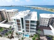 Seamless entry on to your 570 square foot terrace. - Condo for sale at 188 Golden Gate Point #302, Sarasota, FL 34236 - MLS Number is A4187390