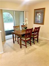 sliders from Dining room to screened front patio, preserve across street - Villa for sale at 510 Villa Park Dr #510, Nokomis, FL 34275 - MLS Number is A4188232