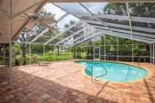 Swimming pool, lanai and yard view - Single Family Home for sale at 3448 Pine Valley Dr, Sarasota, FL 34239 - MLS Number is A4188545