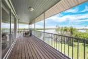 2nd floor screen enclosed wrap around porch - Single Family Home for sale at 2560 Tarpon Rd, Palmetto, FL 34221 - MLS Number is A4189616