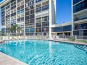 Gulf front swimming pool - Condo for sale at 19 Whispering Sands Dr #205, Sarasota, FL 34242 - MLS Number is A4189914