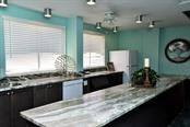Social room kitchen - Condo for sale at 5855 Midnight Pass Rd #628, Sarasota, FL 34242 - MLS Number is A4190416
