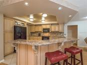 Full kitchen area - Single Family Home for sale at 7520 Weeping Willow Dr, Sarasota, FL 34241 - MLS Number is A4196497