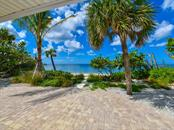 New Paver Patio and Landscaped Backyard Overlooking the Gulf of Mexico - Single Family Home for sale at 418 N Casey Key Rd, Osprey, FL 34229 - MLS Number is A4198549