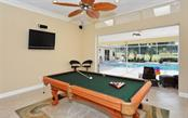 Game room looking out to swimming pool area. - Single Family Home for sale at 3882 Spyglass Hill Rd, Sarasota, FL 34238 - MLS Number is A4206477