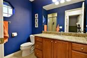 Upstairs Guest bathroom - Single Family Home for sale at 22611 Morning Glory Cir, Bradenton, FL 34202 - MLS Number is A4207071