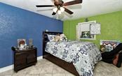 Lower level bedroom 2 - Single Family Home for sale at 141 Ogden St, Sarasota, FL 34242 - MLS Number is A4208039