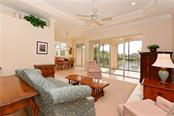 Living room overlooking lanai. - Condo for sale at 5242 Parisienne Pl #201bd30, Sarasota, FL 34238 - MLS Number is A4208770