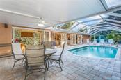 Covered lanai and swimming pool - Single Family Home for sale at 5634 Cape Leyte Dr, Sarasota, FL 34242 - MLS Number is A4209556