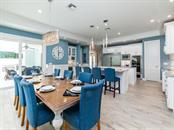 From casual to elegant this dining area accommodates large parties or intimate dining - Single Family Home for sale at 7643 Cove Ter, Sarasota, FL 34231 - MLS Number is A4403215
