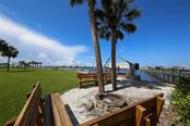 Fire Pit with Benches overlooking the Bay - Single Family Home for sale at 1778 Bayshore Dr, Englewood, FL 34223 - MLS Number is A4405962