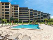 Gulf & Bay Community Pool close to your home. - Condo for sale at 5780 Midnight Pass Rd #208, Sarasota, FL 34242 - MLS Number is A4411755