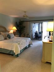 Master bedroom... wake up to beautiful bay views - Condo for sale at 11000 Placida Rd #2304, Placida, FL 33946 - MLS Number is A4413206