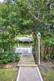 Through the mangroves to your private dock with 10,000LB lift. - Single Family Home for sale at 660 Marbury Ln, Longboat Key, FL 34228 - MLS Number is A4415911