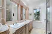 GUEST BATHROOM 1 - Single Family Home for sale at 4121 Founders Club Dr, Sarasota, FL 34240 - MLS Number is A4417319