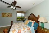 Master bedroom with water views - Condo for sale at 1930 Harbourside Dr #117, Longboat Key, FL 34228 - MLS Number is A4420232
