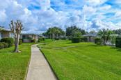 Greenbelt view. - Villa for sale at 3434 Medford Ln #1110, Sarasota, FL 34239 - MLS Number is A4422897