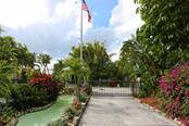 Gated community entrance. - Single Family Home for sale at 737 Eagle Point Dr, Venice, FL 34285 - MLS Number is A4428917