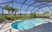 Lake views from the pool - Single Family Home for sale at 13337 Pacchio St, Venice, FL 34293 - MLS Number is A4437569