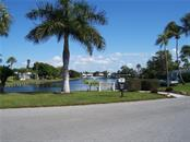 Spanish Main Yacht Club lake entrance - Villa for sale at 717 Spanish Dr N, Longboat Key, FL 34228 - MLS Number is A4438337