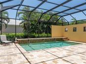 Saltwater pool with fountains - Single Family Home for sale at 158 Puesta Del Sol, Osprey, FL 34229 - MLS Number is A4439362